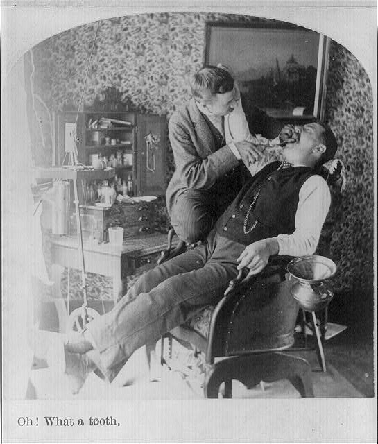 Man in historical dentist chair