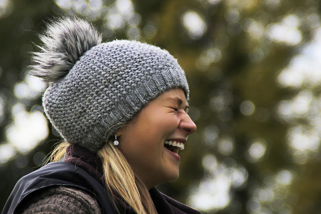 Smiling woman in winter white teeth