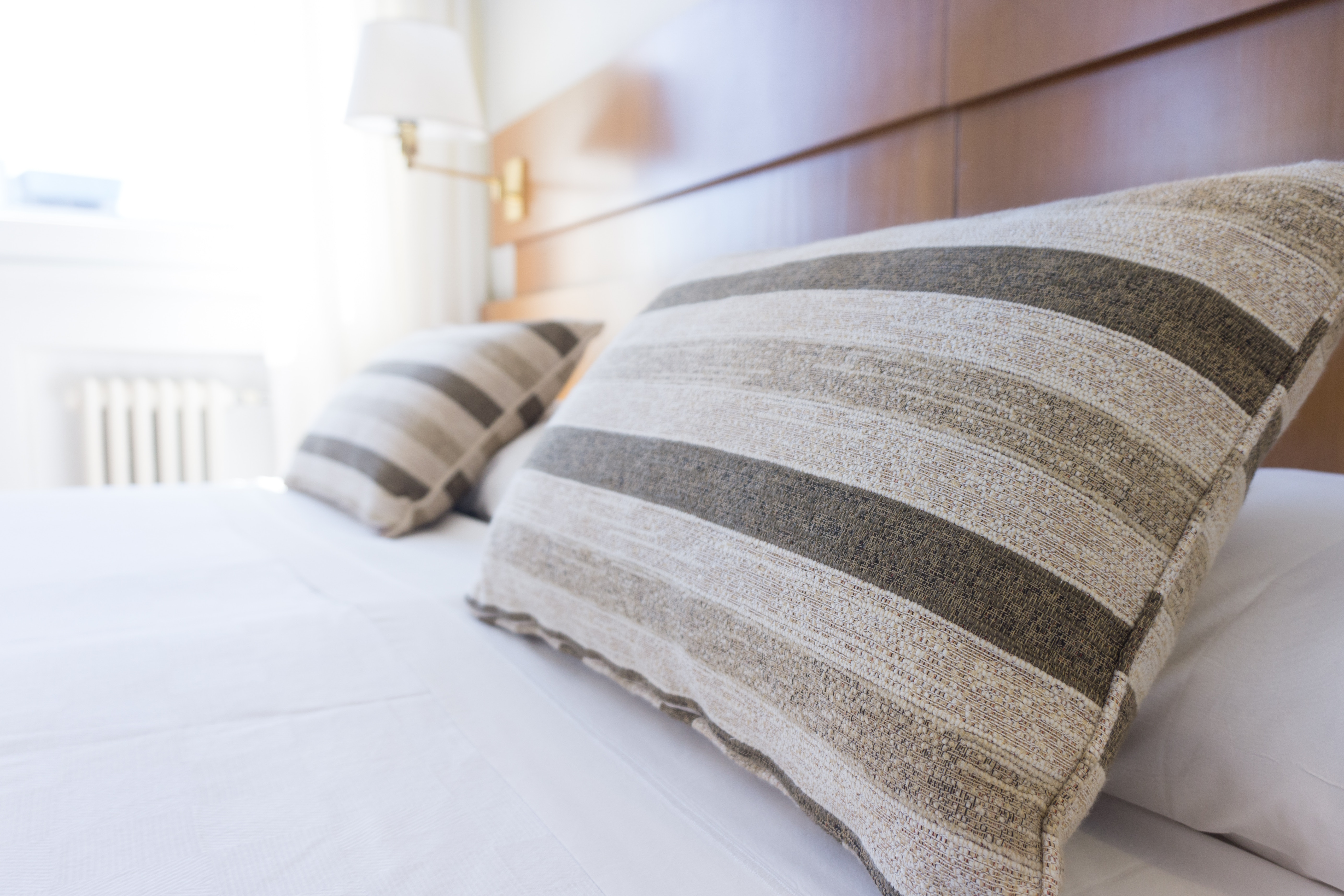 grey striped pillows on bed